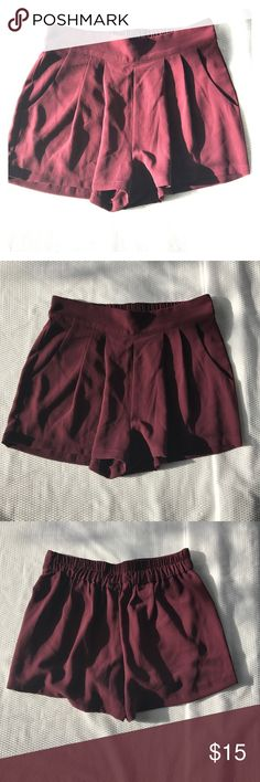 Pleated Shorts Amazing deep purple shorts with a pleated detail in the front, side pockets, and a stretch band at waist. Pair them with booties and a chunky knit sweater for an easy fall look. Available in M & L as well Unlined 100 % Polyester Hand-wash cold Measurements Shorts Skorts