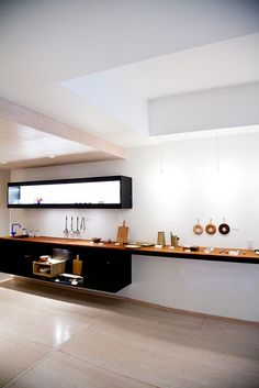 Like the look of floating cabinets.  Also really like the ida of black cupboards and natural wood countertop.