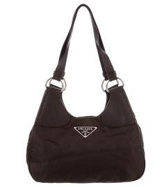 85199bcc8c1f 20 Epic Prada Bags That All Clock in Under  250