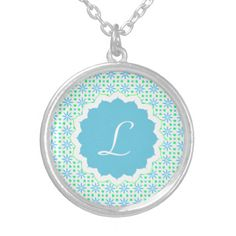 A pretty monogram floral print necklace. Makes a lovely gift.
