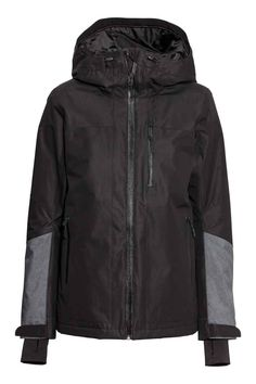 Ski jacket: Padded ski jacket in windproof, water-repellent breathable functional fabric with taped seams at critical points and a lined hood with a peak and elasticated drawstring front and back. The jacket has a taped zip at the front, side pockets and a chest pocket with a taped zip, two inner pockets, one with a zip and the other in mesh, a snow flap with reinforced elastication and press-studs at the waist, velcro tabs and inner ribbing with thumbholes at the cuffs, and an elasticated…