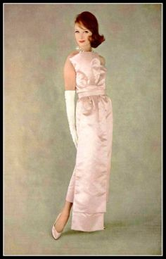 Model in pale pink satin evening gown by Pierre Cardin, photo by Sabine Weiss, 1959
