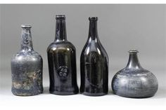 An early 18th Century English onion-shaped glass wine bottle of olive green tint, 6ins high (cir