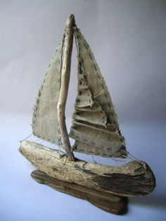 driftwood sailboat with linen sile