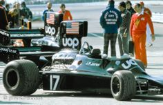 Shadow DN3.  In the foreground in red is Frank Williams.  Behind him talking are Roger Penske and Carl Haas and further back with the beard is Henry Pescarolo.