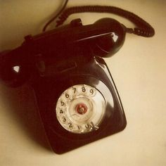 vintage black rotary phone ~ Talked on ones of these many moons ago, we were on a party line.....