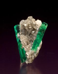 Beryl var. Emerald on Calcite -   Muzo, Boyacá Department, Colombia  2.8 x 1.8 x 1.7 cm. http://www.mineralmasterpiece.com/Sold_Specimen_p9.html
