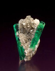 Beryl var. Emerald on Calcite -   Muzo, Boyacá Department, Colombia  2.8 x 1.8 x 1.7 cm. http://www.mineralmasterpiece.com/Sold_Specimen_p9.html