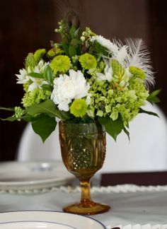 Green and White Centerpiece in Brown Glass Goblet