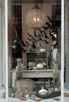 Window decor stylish Halloween look. Love the swarm of black paper bats paint pumpkins white Halloween Window Display, Halloween Window Decorations, Halloween Displays, Halloween Diy, Classy Halloween, Halloween House, Holidays Halloween, Vintage Halloween, Store Window Displays