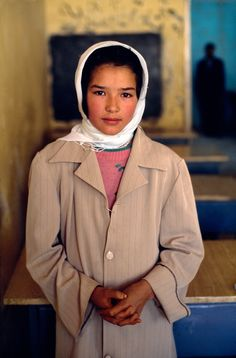 This young Hazara schoolgirl was photographed in her classroom in Bamiyan, Afghanistan.