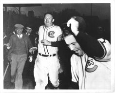 """September 28, 1938  Gabby Hartnett hits what is called the """"Homer in the Gloamin'"""" in the 9th inning against the Pirates' Mace Brown.  The victory is important in   allowing the Cubs to go on to win the NL Pennant.   Picture from """"Agony and Ivy"""" website  and an article about this famous Chicago Cubs home run."""