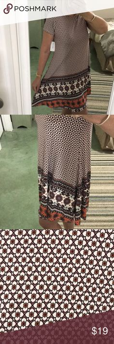 Tan Boho Print Design Dress New with tags very comfy stretchy swing dress with stylish boho print. Would look great with my fringe hobo bag! Sauci Dresses Midi