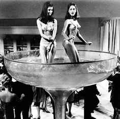 Roseann Williams and Tara Glynn dance in a giant champagne glass in Criss Cross (later re-named P.J.) 1968