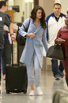 March 1: Selena arriving at an airport in Atlanta, Georgia