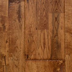 """Golden Honey from our Reclamation Plank Collection by Heritage Woodcraft is a hand-scraped (7-7/8"""") wide-plank solid oak hardwood flooring. It's solid construction and wide plank width is achieved by finger-joining three sections of solid oak hardwood together prior to the hand-sculpting of the plank."""