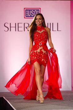 Although I haven't seen that many high-low dresses in the prom world yet, they are definitely still in for pageantry and Tiffany Teixeria is rocking this one! This bright red color is definitely a show-stopper and would turn the heads of everyone around you. The high neckline draws the eye to her gorgeous face while the cut of the dress shows off her long legs. This outfit would be great for a fun fashion outfit for a contestant of any age!