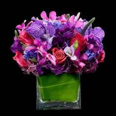 Pink and Purple - A joyous proclamation of the splendors of flora with a beautiful mix of calla lilies, coxcomb, orchids, roses, veronica wrapped in green leaves. Soft pinks and purples give the bouquet a light and romantic feel. Purple Passion Flower, Purple Flower Bouquet, Orchid Bouquet, Pink And Purple Flowers, Pretty Flowers, Purple Baby, Beautiful Bouquets, Colorful Flowers, Pink Flower Centerpieces