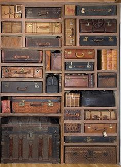 great idea !  A cool way to use those old suitcases & trunks for storage but contained in a built-in shelving space!