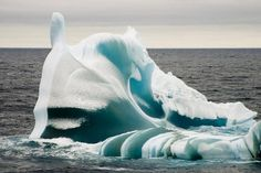 Weather pics from Bureau of Meteorology 2011 calender.  A combination of light and frozen sea water gives a greenish tinge to this iceberg in the waters between Casey and Davis Bases in Antarctica.