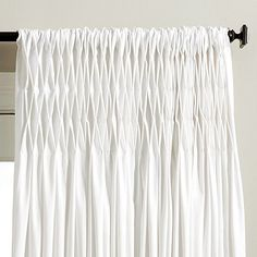 Haute couture for your windows. Our Surrey Panel is dressed in elegant tailored smocking that creates fullness and a stylish flair at the bottom. Made of Super White cotton twill. Hangs from 3 rod pocket or included pins. Surrey Pleated Panel features:Lined for privacy & sun protectionIncludes 10 drapery pinsImported