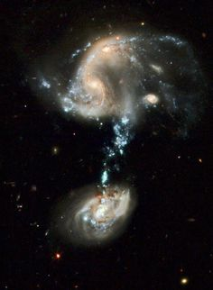 This interacting group contains several galaxies, and a cosmic source of stars, gas and dust that is more than 100,000 light years. The top of Arp 194 appears as an unordered collection of spiral arms full of dust, bright blue and star-forming regions, plus at least two cores of galaxies that appear to be connected and in the early stages of fusion. A third galaxy, relatively normal and spiral to the right. In the bottom of the image, the galaxy group contains a single large spiral galaxy..