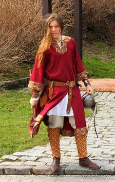 Norman The red tunic made of cotton damask and decorated with brocade. Ca 11th century.