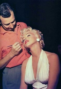 Marilyn Monroe getting her make-up done during the shooting of The Seven Year Itch, 1955