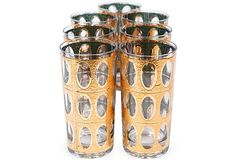 Set of seven tall vintage glasses with gilded oval motif.