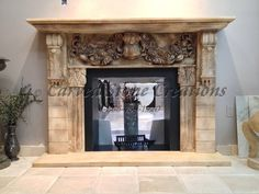 This intricately carved antiqued white marble fireplace is a classic! Click on the picture to view more fireplace designs. #Fireplace #Design #Home #Decor #Stone #Marble