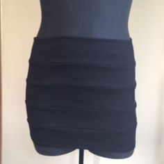 Black tube bandage skirt Has never been worn. Could fit size small/medium. Label says medium. Skirts