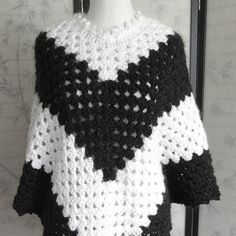 Poncho Black and White Boho Style Handmade Crochet by knitwhats A lovely boho style poncho. Created in black and white blocked stripes. Cape style poncho with pointed front and back. A detailed picot neckline and picot edging finishes off the top and bottom of the versatile piece. The stitches used are so very pretty.  A great piece for the changing seasons. A wonderful layering piece! Bulky weighted so it is on the warmer side.  One Size Fits most (Small, Medium, Large)