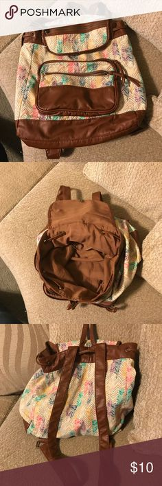 Back Pack Almost new back pack brown with nice colors decor with feather print with different size pockets. Bags Backpacks