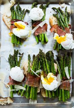Asparagus wrapped with bacon, poached egg on top