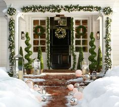 Natural outdoor Christmas decorations in entry space with wreaths