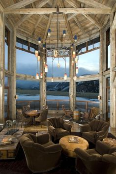 Rugged Montana Wilderness outside Towering 2-Story Bay Windows, Hand-Hewn Timber + Custom Industrial Hand-Blown Glass Chandelier [2400 x 3600] : DesignPorn
