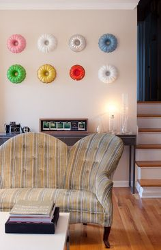 perfect backdrop for a baking party. how i wish i didn't throw out all those vintage cake pans i collected in uni.    LAURA PARKE: BUNDT PAN WALL