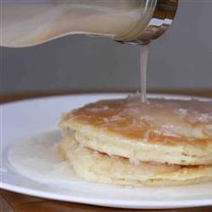Coconut Pancake Syrup   1 (13.5 ounce) can coconut milk   2 tablespoons cornstarch   2 cups light corn syrup   1/2 cup white sugar   1/2 cup shredded sweetened coconut  Whisk together the coconut milk and cornstarch in a saucepan until the cornstarch is dissolved. Pour in the corn syrup, sugar, and coconut; bring to a boil, stirring continually. As soon as the mixture comes to a rolling boil, remove from heat. Allow to cool completely before serving.