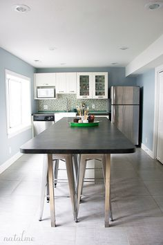 Home Tour {Craft Room}-This woman's craft space is insanely awesome.  I love that penny tile.