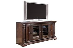"The Key Town TV Stand from Ashley Furniture HomeStore (AFHS.com). The rich beauty of the ""Key Town"" entertainment wall features a sophisticated finish and ornate details to create a traditional designed entertainment center that is sure to enhance any living area."