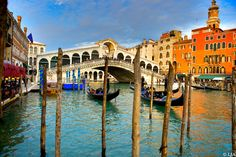 Venice colorful Rialto Bridge gondoliers colorful sunny sky and beautiful grand canal 10 x 15 Fine Art Signed Photograph Print by LJAPhotography, $30.00 What can i say, most of the time it rained..this day it shined. This photograph depicts Venice in its glory, the vibrancy and life that the grand canal holds.