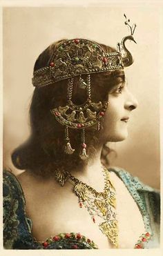 art nouveau era, woman with a peacock Cleopatra headdress