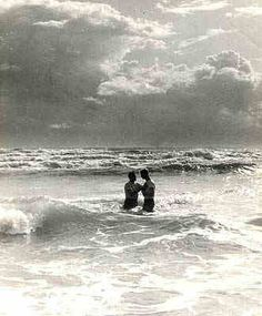 Baptism, South China Sea - 1966  Navy Chaplain baptizes sailor in the surf at SCS
