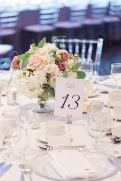 Day-of Wedding Coordination via Elegant Productions | Silver Hotel Wedding Reception, Hydrangea Floral Centrepiece, Clear Chiavari Chairs