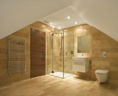 A bright, airy, modern tiled bathroom.