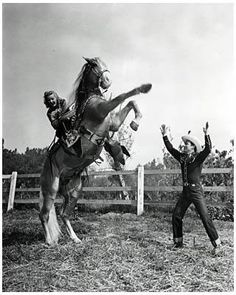 """Roy Rogers """"King of the Cowboys"""" and Dale Evans """"Queen of the West"""". Teaching Dale to ride a rear."""