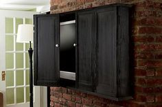 These ideas for how to hide the TV are awesome! Whether your TV is over the fireplace, on a wall or in the living room one of these ways to make a TV cover up will help keep the television out of sight. Hanging Tv On Wall, Wall Mounted Tv, Wall Tv, Hide Tv Over Fireplace, Tv Cover Up, Tv Diy, Hidden Tv Cabinet, Best Tv Wall Mount, Mount Tv