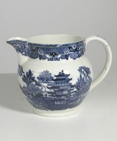Staffordshire blue and white printed jug, Worcester Pagoda pattern. Cracked. 1860-1880