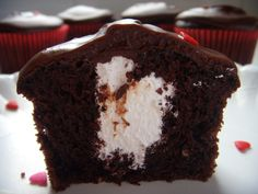 Marshmallow-filled devil's food cupcakes with chocolate ganache frosting!
