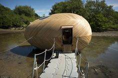 Meet the man who lives - and works - in an egg: Giant floating wooden pod is artist's studio and home #Homestead #Prepper